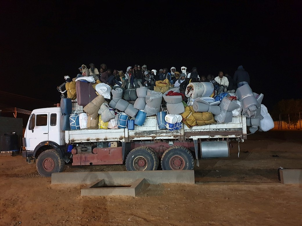Migrantes y refudiados expulsados del centro de detección de al-Kufra DCIM / Source: Illegal Migration Detention and Expulsion Centre - al-Kufra on 15 May 2020